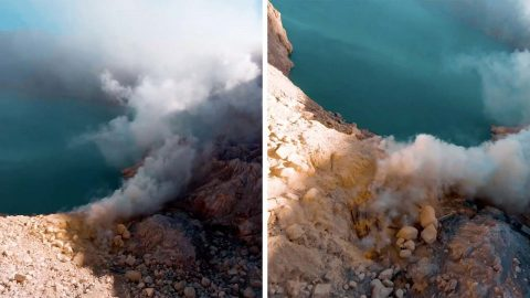 SPECTACULAR MOMENT DRONE FLIES DOWN HUGE VOLCANO CRATER SPURTING SULHPUR INTO AIR Image