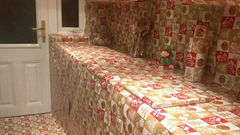THAT'S A WRAP! – PRANKSTER PARENTS WRAP THEIR ENTIRE KITCHEN IN CHRISTMAS PAPER AND BLAME THE ELF Image
