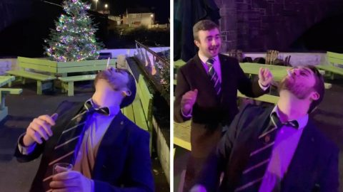 WHAT A FLIPPING GREAT TRICK! MAN MANAGES TO USE HIS MOUTH TO FLIP AND CATCH LIT CIGARETTE Image