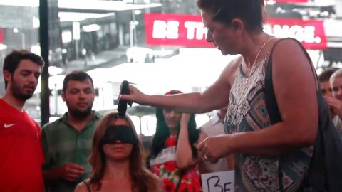 BLINDFOLDED WOMAN ALLOWS STRANGERS TO SHAVE HER HAIR COMPLETELY OFF - IN A BID TO PROMOTE SELF ACCEPTANCE Image