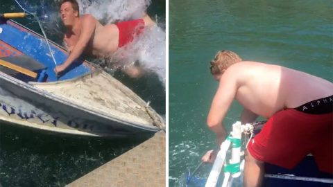 HE'S GONE OVERBOARD! THIS MAN'S ATTEMPT TO SHOW OFF HIS FISHING SKILLS GOES WRONG AS HE ENDS UP IN THE WATER Image