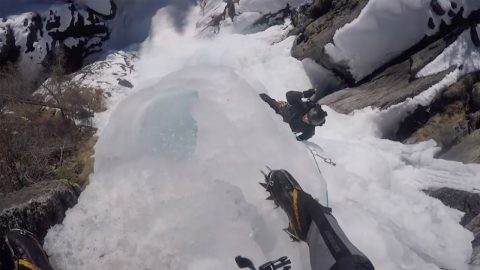 ICE CLIMBERS PUT THEIR SKILLS TO THE ULTIMATE TEST AS THEY SCALE A DANGEROUS, FROZEN WATERFALL Image