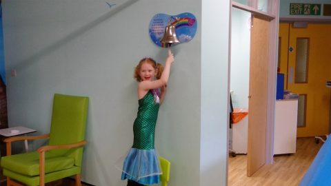 BRAVE CANCER SURVIVOR RANG THE BELL AT THE END OF HER CHEMO DRESSED AS A MERMAID, BEFORE GETTING TO ADOPT AN ACTUAL DOLPHIN Image