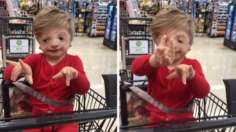 YOUNG BOY WITH RARE SYNDROME WHICH AFFECTS HIS SPEECH AND HEARING AMAZED HIS MUM WHEN HE SIGNED 'I LOVE YOU' Image