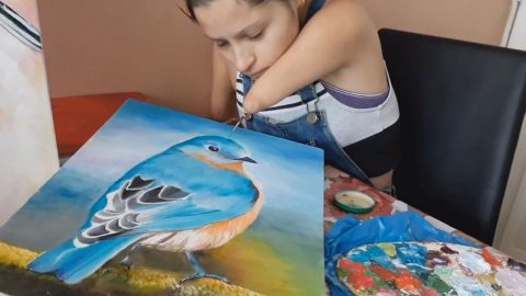 ARTIST BORN WITHOUT HANDS CREATES AMAZING BLUEBIRD PAINTING Image
