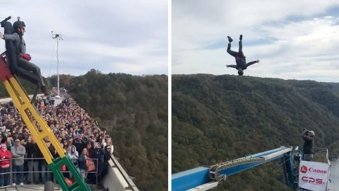 DAREDEVIL IS CATAPULTED OFF BRIDGE IN INCREDIBLE BASE JUMPING VIDEO Image