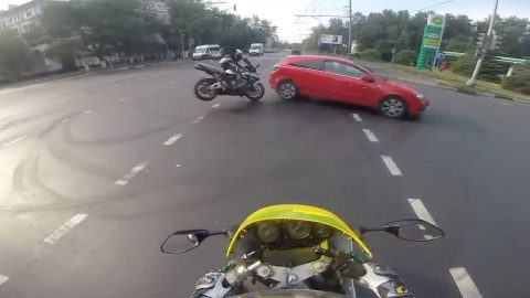 SHOCKING MOMENT MOTORCYCLIST COLLIDED WITH CAR CAUGHT ON HELMET CAM Image