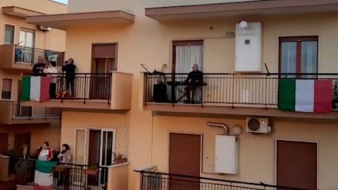 OVER 300 PEOPLE STEP ON BALCONIES TO SING ITALIAN NATIONAL ANTHEM AMID CORONAVIRUS LOCKDOWN Image