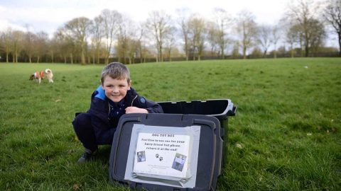 DOG-SESSED! KIND HEARTED SCHOOLBOY GOES VIRAL AFTER LEAVING WATERPROOF DOG TOYBOXES IN LOCAL PARKS FOR POOCHES TO USE Image