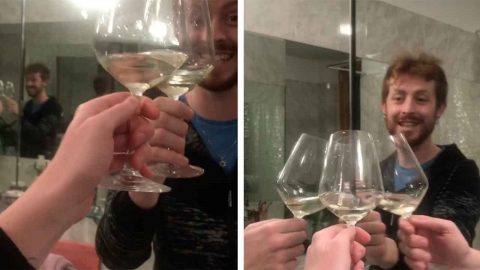 ITALIAN GUY USES MIRRORS TO HAVE A SOLO TOAST DURING COVID-19 QUARANTINE Image