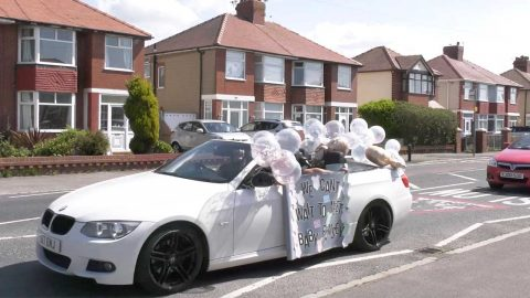 MUM-TO-BE SURPRISED WITH DRIVE-BY BABY SHOWER Image