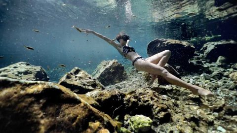 BREATHTAKING IMAGES EMERGE OF FREE DIVER IN MEXICAN CENOTE Image