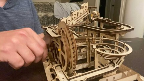 CREATIVE MAN BUILDS INTRICATE WOODEN MARBLE RUN DURING QUARANTINE Image