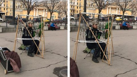 TALENTED BUSKER PLAYS CLASSICAL MUSIC USING BOTTLES Image