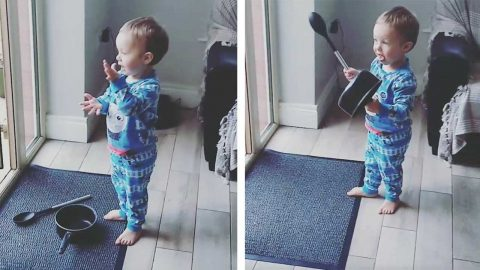 LITTLE BOY PRACTISES CLAPPING FOR ESSENTIAL WORKERS Image