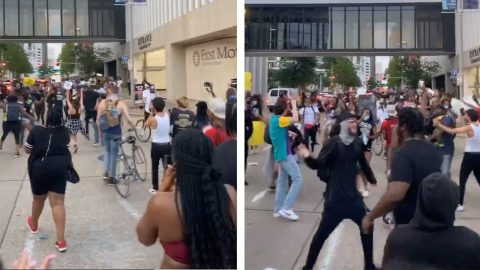 TWO GROUPS OF PROTESTORS MEET UP IN THE STREETS OF HOUSTON AND REJOICE FOR A BRIEF MOMENT Image
