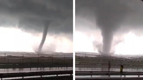 MAN CAPTURES TERRIFYING VIDEO OF MASSIVE WATERSPOUT WHILE DRIVING THROUGH HIGHWAY Image