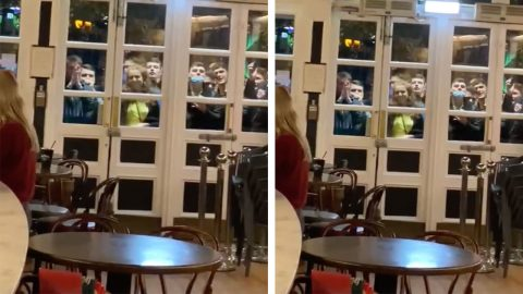 VIRAL VIDEO SHOWS FOOTBALL FANS CELEBBRATING SCOTTISH VICTORY IN EURO QUALIFIERS AFTER WATCHING FINALE THROUGH WINDOW OF BAR DUE TO COVID CURFEW Image