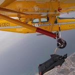 Now That Is An Inflight Snack! Wingsuit Pilot Passes Banana To Plane Passenger Hanging Out Of Door In Mid-flight