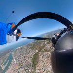 Dizzying Footage Shows Wingsuit Pilot Struggle To Unhook Parachute After It Gets Tangled On Descent