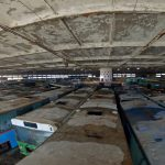 Urban explorer discovers hundreds of abandoned vehicles in spooky spaceship shaped building