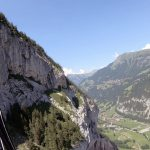 Terrifying Footage Shows Paraglider Crash Into The Side Of A Cliff Only To Right Himself And Land Like Normal