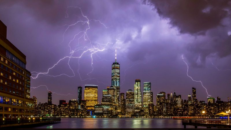 Thunderbolts and lightning!! Spectacular timing as photographer captures huge lightning strike over iconic NY skyline Image