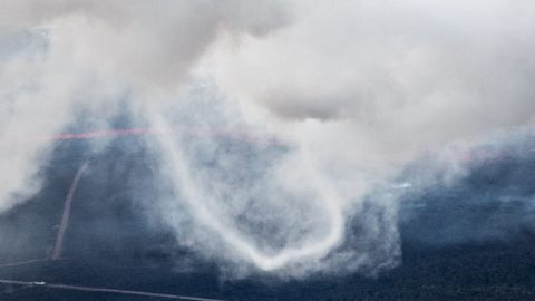 Incredible photos show rare 'ring twister' vortex captured for first time at Hawaii volcanic eruption site Image