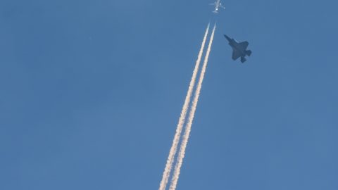 Perfectly-timed image captures speeding jet planes crossing Image