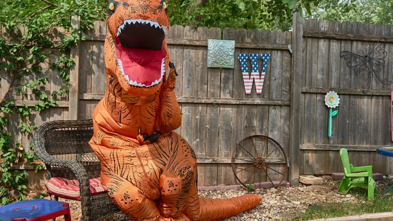 Jurassic lark: real estate agent dresses as 7ft dinosaur to sell everyday family home in hilarious shots Image