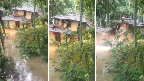 Heavy flooding causes two storey house to collapse Image
