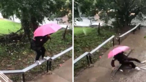 """""""this what you got to do for the fly"""" : Hilarious moment guy trying to keep his trainers dry walks along railing on to fall on his backside in a puddle Image"""