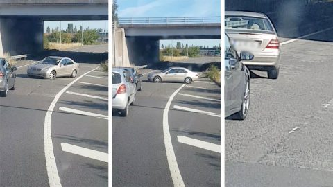 Daft motorist drives into oncoming traffic - with flat tyre Image