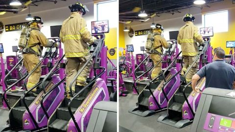 Firefighters take to gym stairmasters to climb 110 floors while dressed in full gear in memory of September 11 victims Image