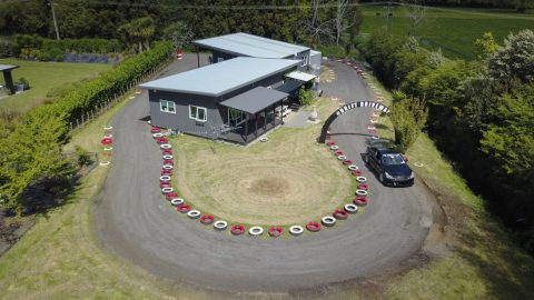 NZ dad turns home into racetrack - by building £8,000 track around house  Image