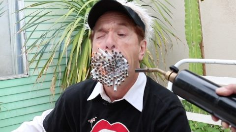The world's biggest mouth: Crazy comedian boasts bizarre ability to smoke over 150 cigarettes at once Image