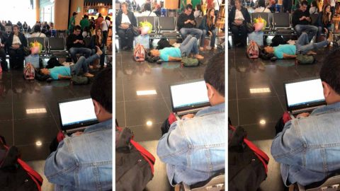 Barefoot passenger performs stretching exercises laying down on airport floor Image