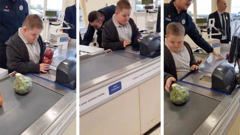 Adorable Boy With Down's Syndrome Invited To Serve Behind The Till Of ' Favourite Shop' After Supermarket Manager Noticed Him Playing In  A Closed Lane Image