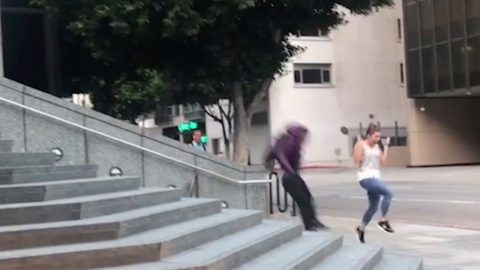 Hilarious moment jogger gets in the way of a skater  Image