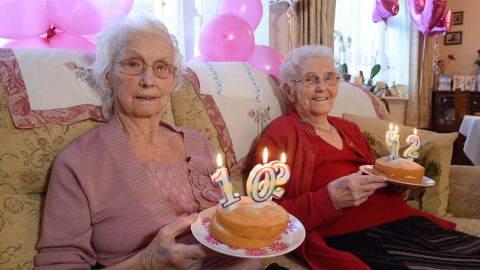 102-year-old sisters celebrate becoming Britain's oldest twins – with a party for friends and family Image
