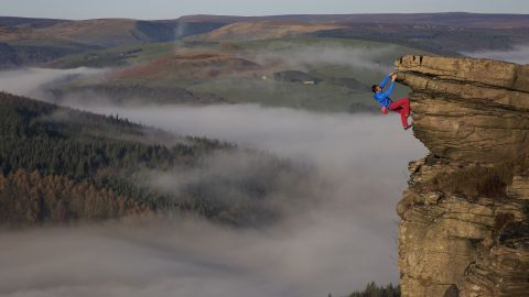 The ultimate cliff hanger – Man captures himself dangling above clouds in Peak District Image