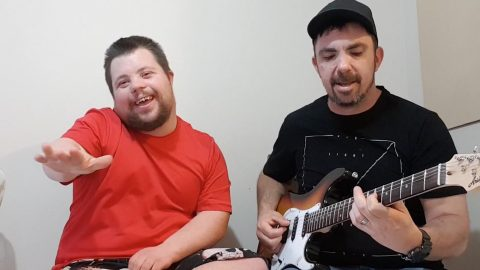 Music teacher forms viral bond by performing well-known hits with down syndrome pupil Image