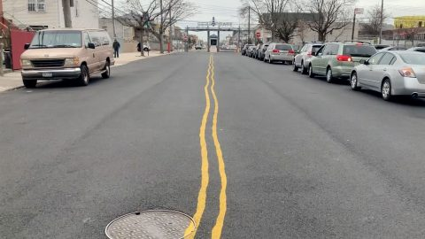 Optical illusion road markings appear wobbly when looked at straight on Image