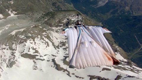 Don't look down (literally): daring wingsuit pilot soars through the air upside down, not even looking at the ground below Image