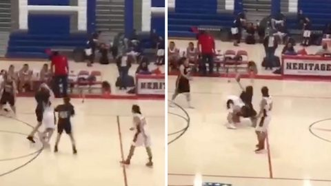 Schoolgirl flips over in air after basketball body throw Image