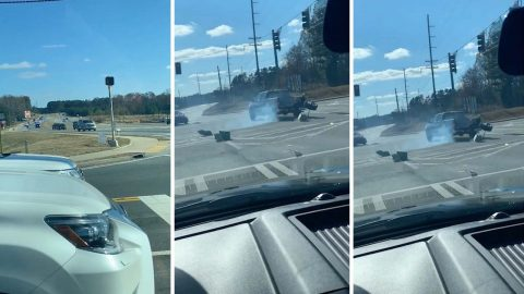 Dramatic video shows suv caught in high-speed chase spin out on highway before suspect tries to flee Image