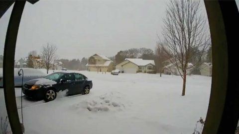 Unlucky Driver Reaches Top Of Snowy Driveway Only To Skid All The Way Back Down Image