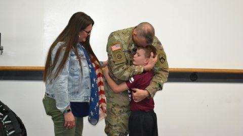 Soldier returns for deployment after 10 months away to shock tearful son during taekwondo sparring session Image