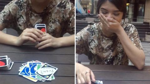 Girlfriend Left Speechless After Boyfriend Asks Her To Prom While Playing Uno Image