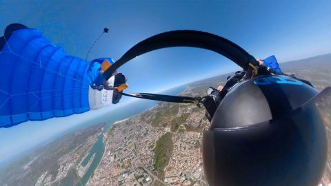 Dizzying Footage Shows Wingsuit Pilot Struggle To Unhook Parachute After It Gets Tangled On Descent Image